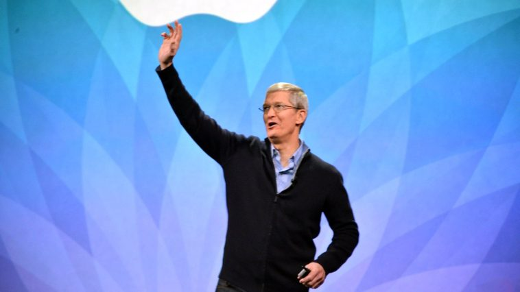 Apple's Tim Cook waves at the Apple Watch launch event. [Image Source: The Verge] -
